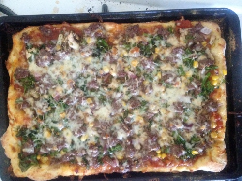 cornmeal crust pizza with grond beef